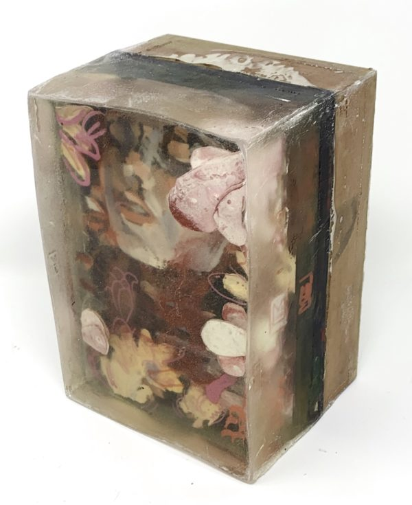 a painting with sculptural elements embedded in resin